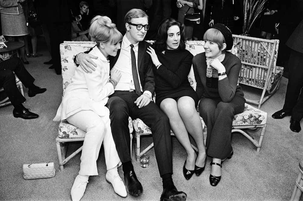 Alfie star Michael Caine with, from left, Julia Foster, Eleanor Bron and Cilla Black, March 1966