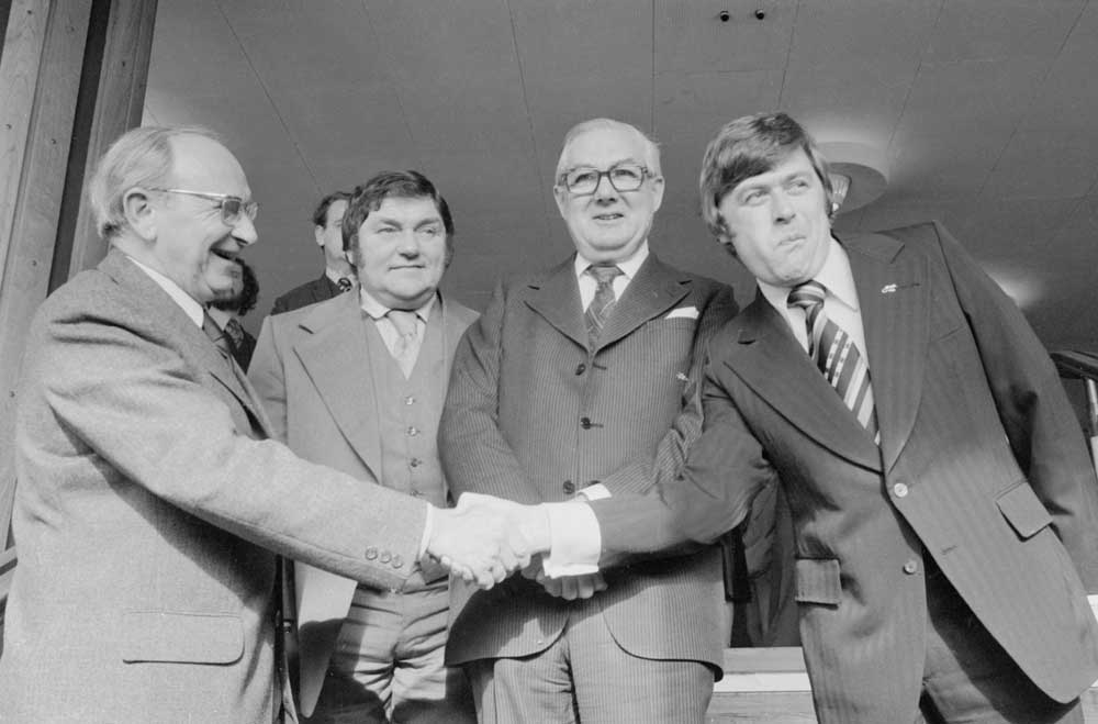 Mike Yarwood, right, shakes hands with Jack Jones at his retirement with Les Dawson and James Callaghan, February 1978