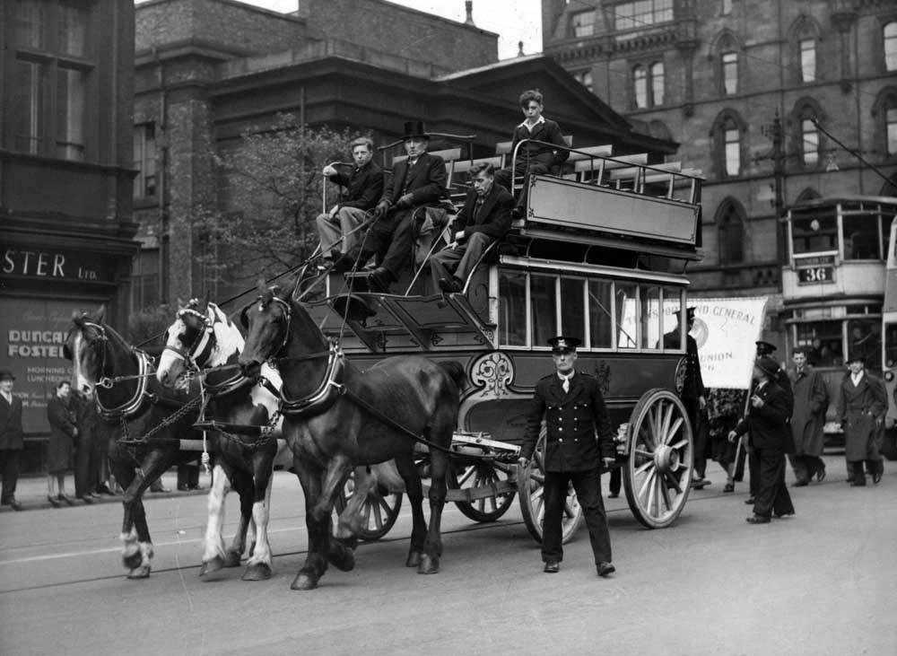 A horse-drawn tram helps lead the Manchester victory parade, May 1945