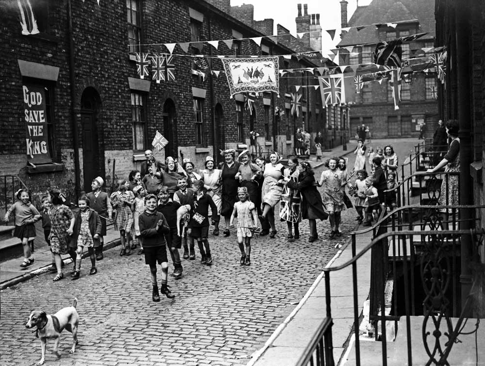 Victory celebrations start early on a Manchester street, May 1945