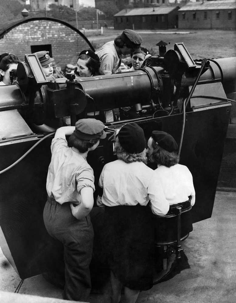 Girls' Training Corps members look over an anti-aircraft gun in Liverpool, September 1942