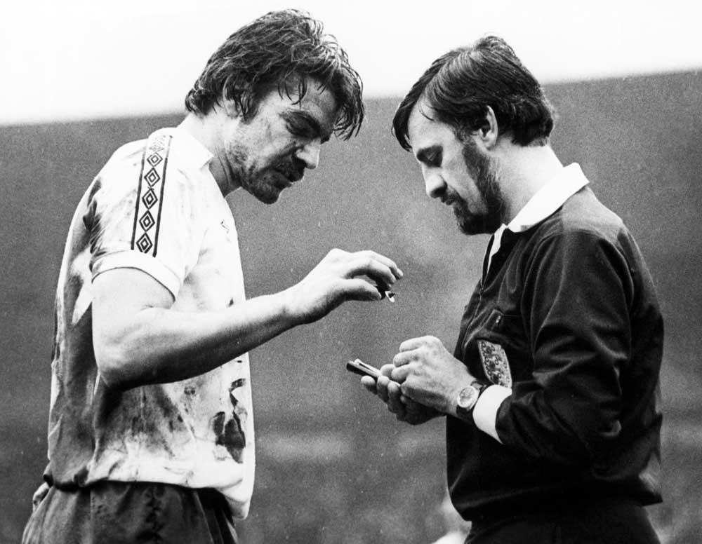 Sam Allardyce inspects a piece of metal retrieved from the pitch, February 1978