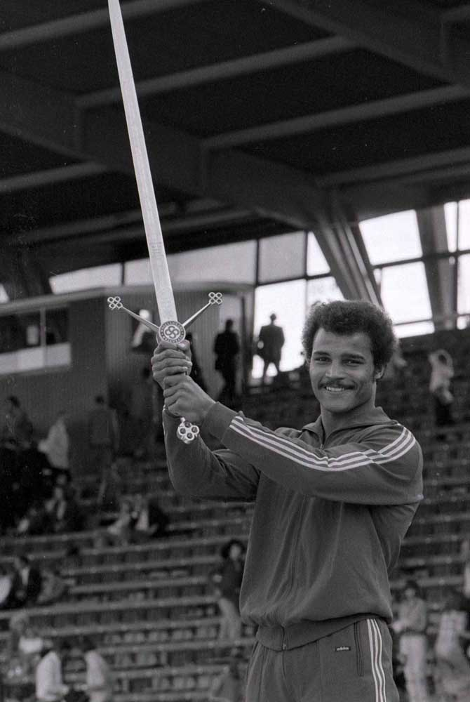 Liverpool boxer John Conteh holds the victor's sword on Superstars, July 1974