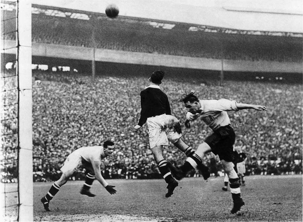 Tommy Lawton, right, in England's 2-1 victory against Scotland, April 1939