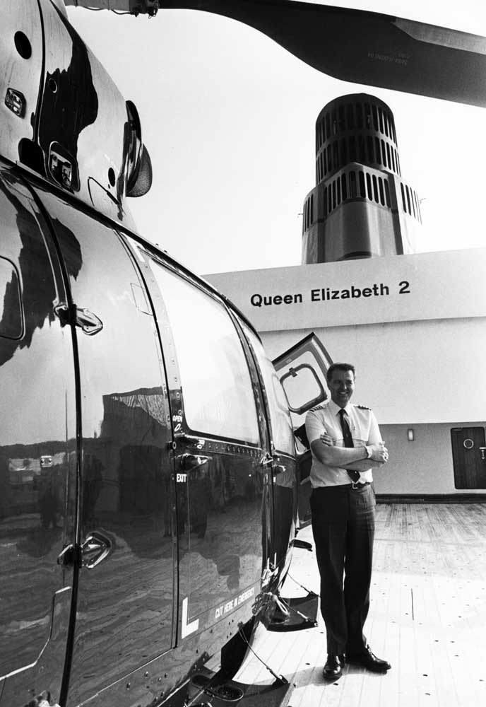 Helicopter pilot Captain David Warren aboard the QE2 in Liverpool, July 1990