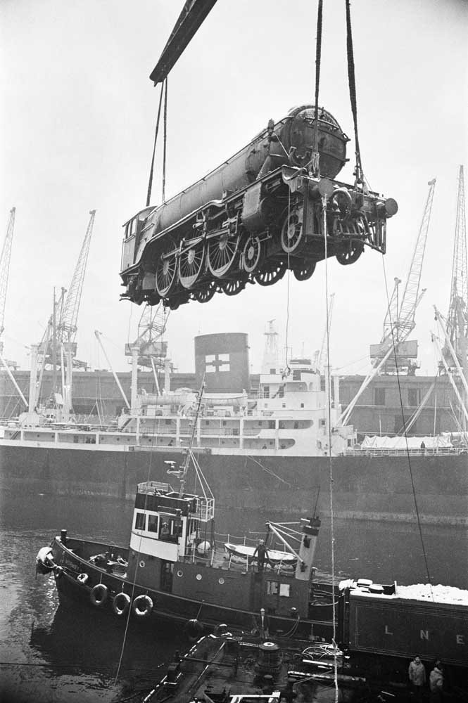 Hoisted high by crane – the airborne Flying Scotsman is landed at Liverpool, February 1973