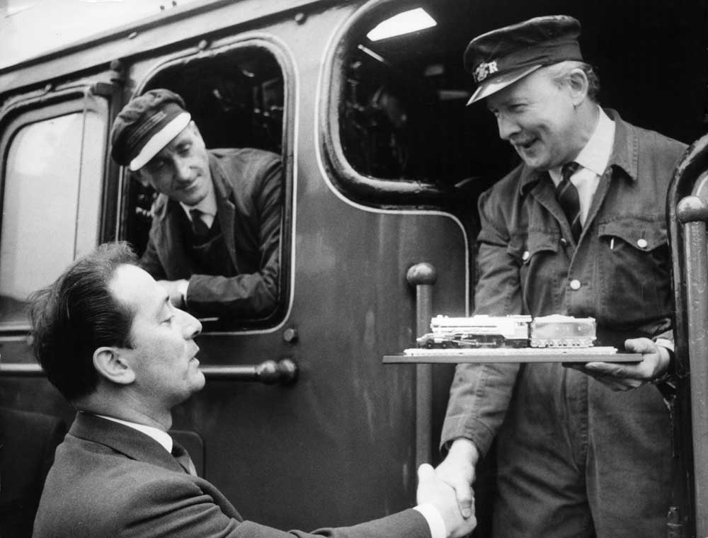 Owner Alan Pegler, right, is presented with a replica of the Flying Scotsman, May 1968