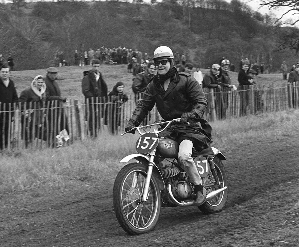 Motorcycle enthusiast Roy Orbison riding a scrambling bike in Shropshire, March 1966