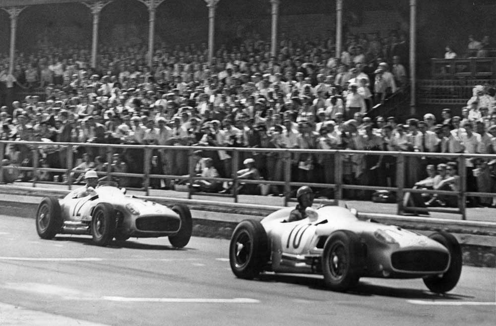 Fangio leads Stirling Moss in the British Grand Prix at Aintree, July 1955