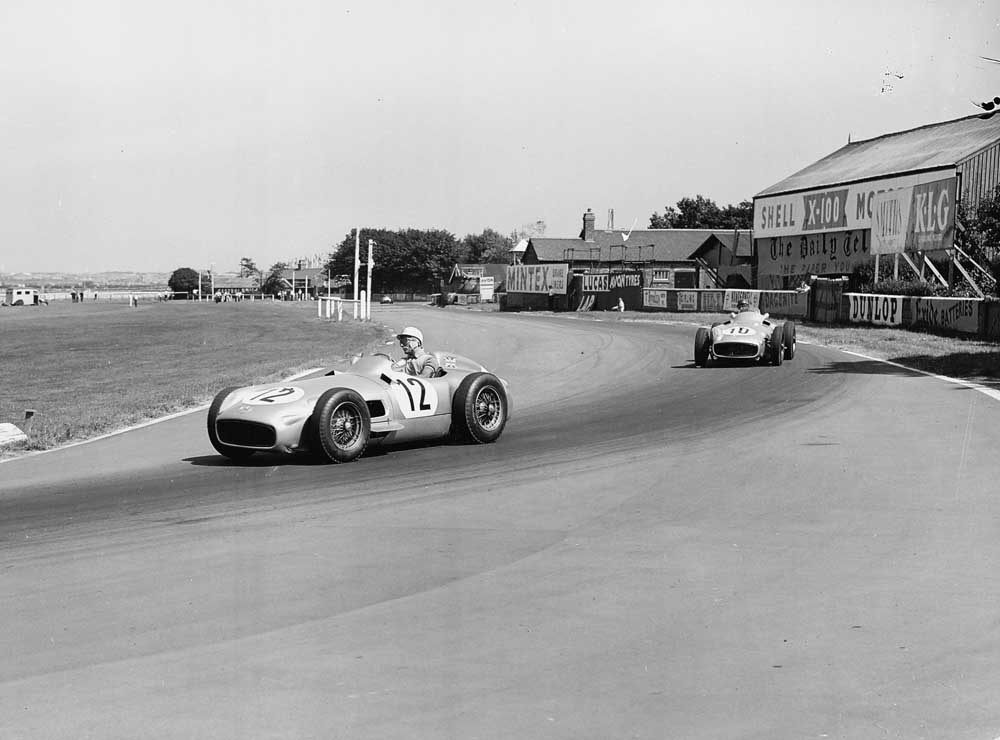 Stirling Moss in his Mercedes ahead of Fangio at the British Grand Prix, July 1955
