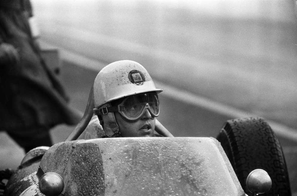 Italian driver Giancarlo Baghetti plagued by spray at Aintree, July 1961