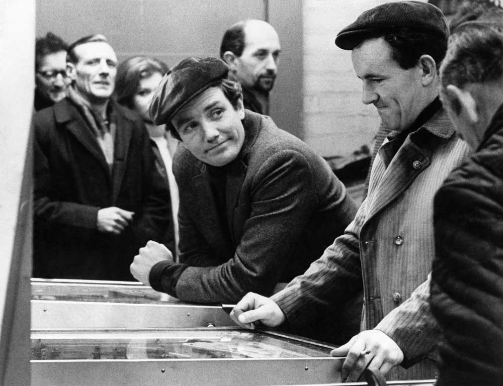 Albert Finney films a scene for Charlie Bubbles in a Manchester arcade, November 1966