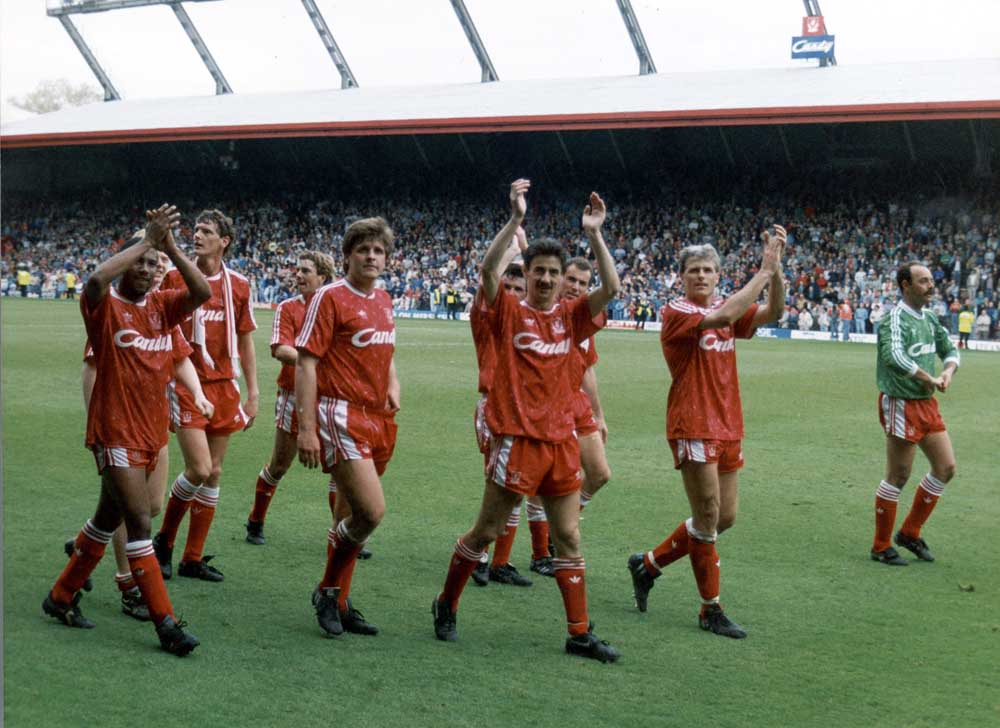 Jan Molby, centre, and team-mates clinch the league championship at Anfield, April 1990