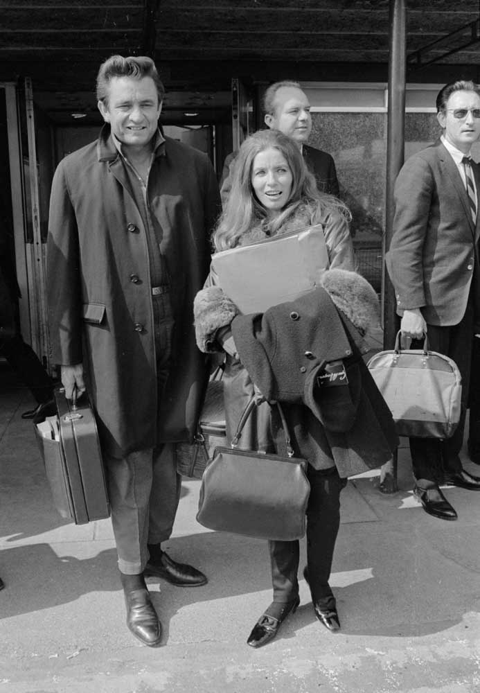 Johnny Cash and his wife June Carter Cash fly in from the USA for their UK tour, May 1968
