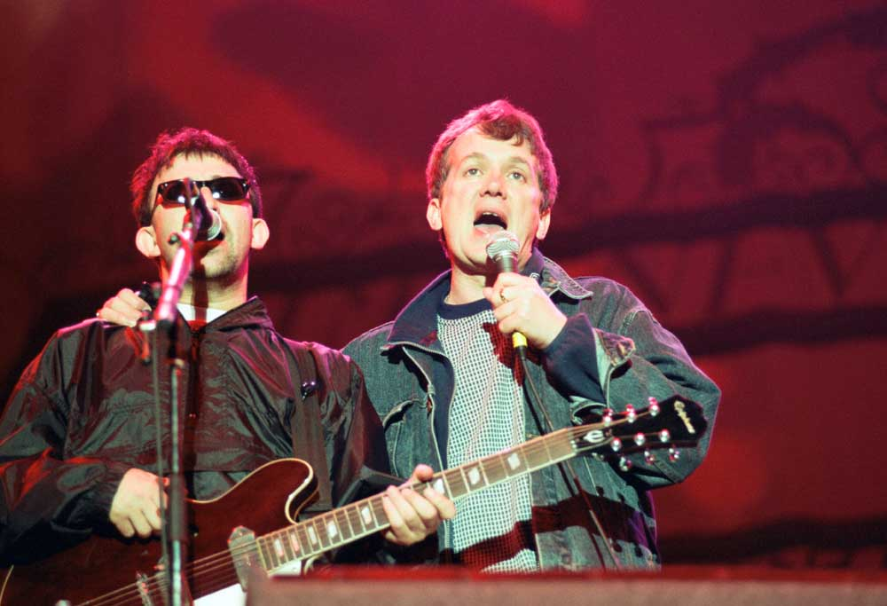 Frank Skinner and Ian Broudie on stage at Anfield, May 1997