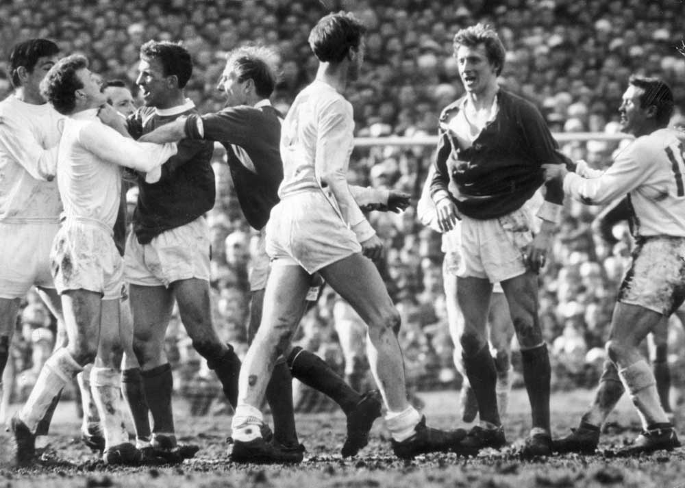 Denis Law in torn shirt squares up to Jack Charlton in the 1965 FA Cup semi-final
