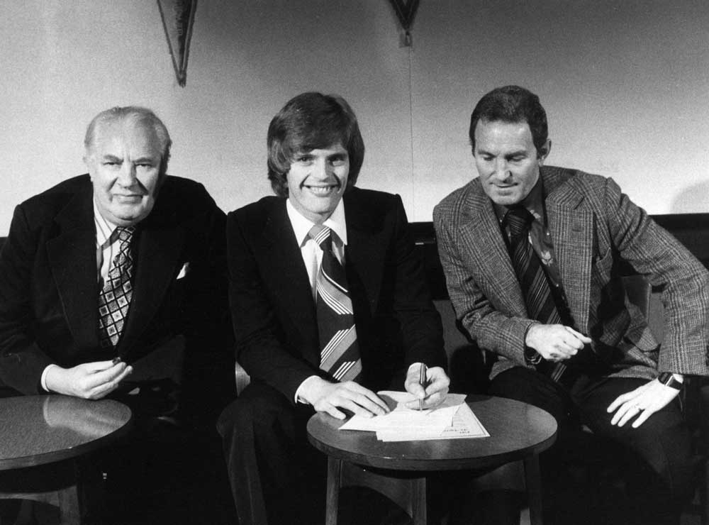 Gordon McQueen signs for United with chairman Louis Edwards and manager Dave Sexton, January 1978