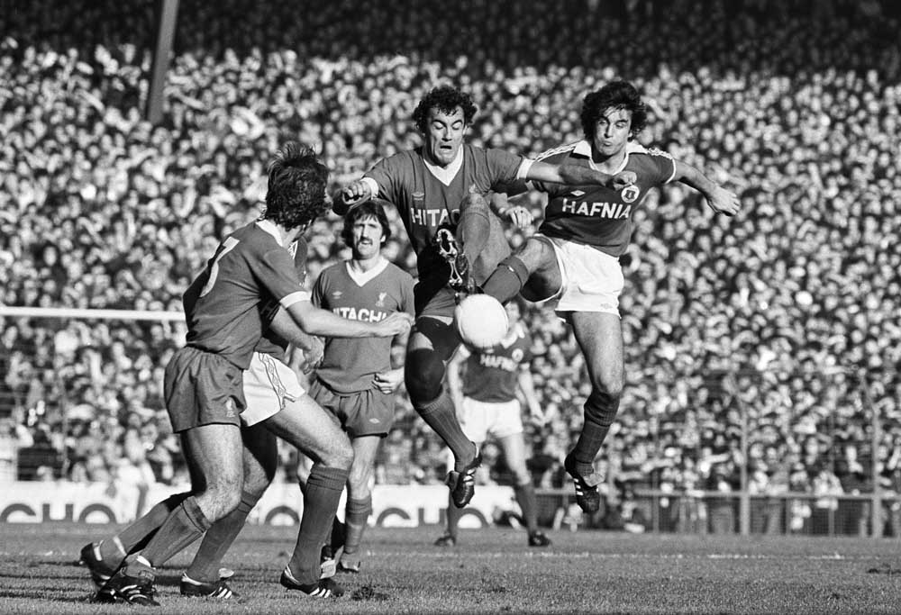 Liverpool's Ray Kennedy challenges Bob Latchford in a local derby, October 1979