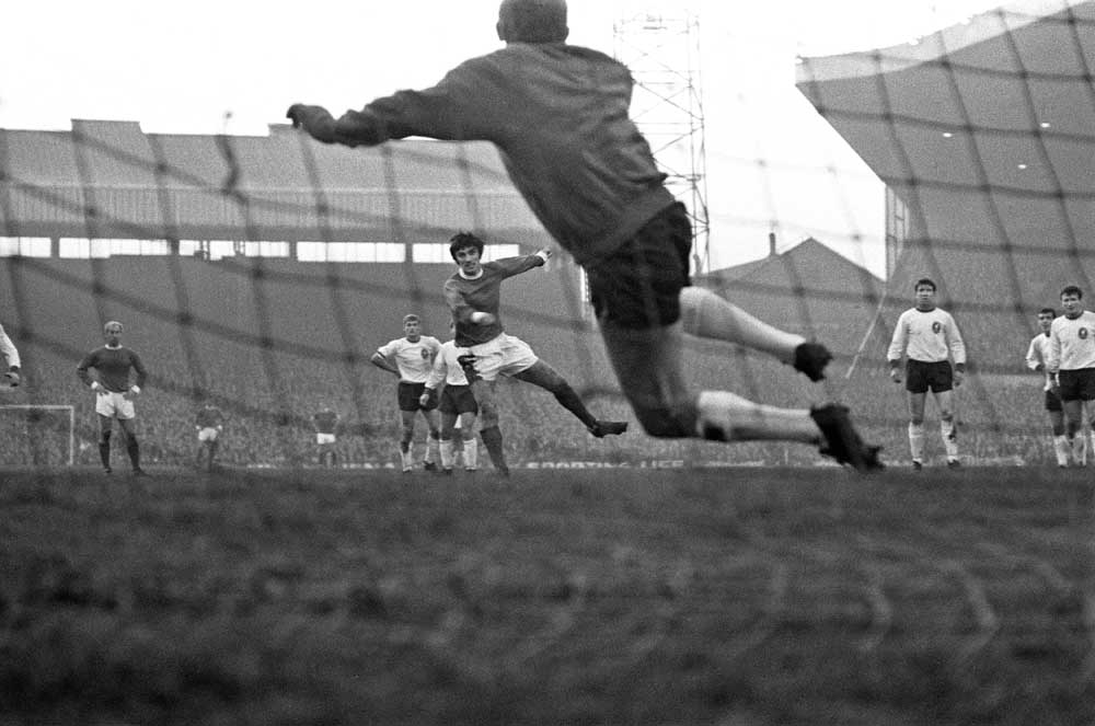 George Best scores against Liverpool in the 2-2 draw at Old Trafford, December 1966