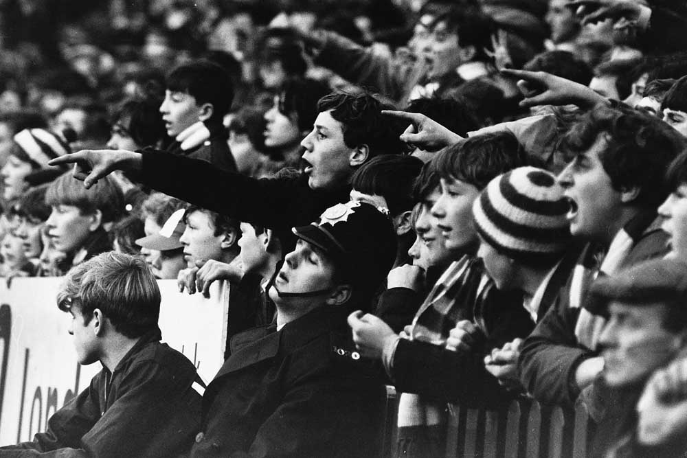 A policeman oblivious to the noise of the crowd at Old Trafford, December 1966