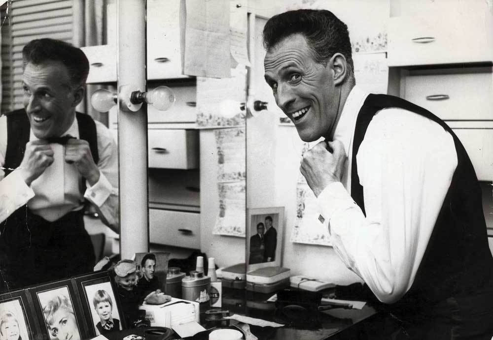 Popular stage and TV star Bruce Forsyth in his dressing room, February 1964