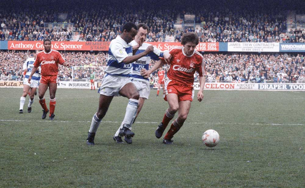 Queens Park Rangers players close down Liverpool's Peter Beardsley, March 1990