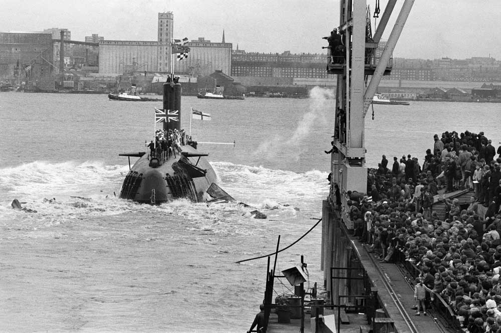 Crowds cheer the launch of HMS Conqueror on Merseyside, August 1969