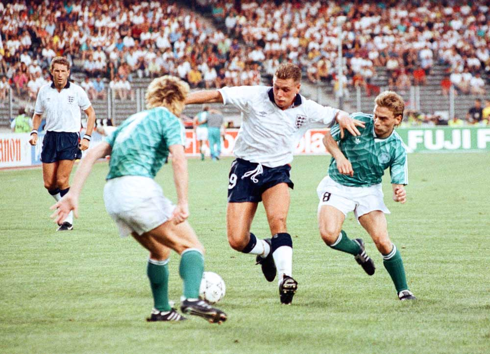Andreas Brehme, left, and Thomas Haessler of West Germany sandwich Paul Gascoigne at Italia 90