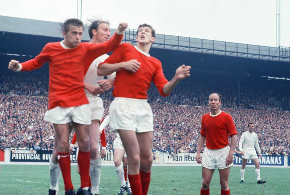 Leeds 2-2 Man United, League division one match action, Elland Road, Saturday 6th September 1969, John Fitzpatrick and Alan Gowling of Manchester United v Jack Charlton of Leeds United, Bobby Charlton in background.